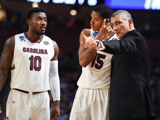 South Carolina head coach Frank Martin speaks with South Carolina guard PJ Dozier (15) and South Carolina guard Duane Notice(10) during the 1st round of the NCAA Tournament at Bon Secours Wellness Arena in downtown Greenville on Friday, March 17, 2017.