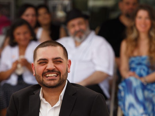 Michael Costello laughs as he listens to a friend speak at his Palm Springs Walk of Stars dedication ceremony on Palm Canyon Drive, Monday, March 20, 2017.