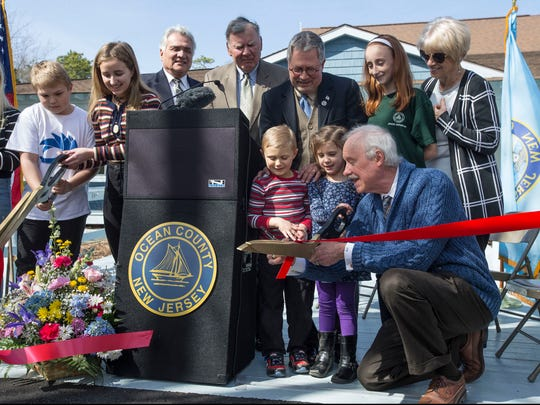 Michael and Sarah Mangum, both 5, help Freeholder John C. Bartlett Jr. cut the ribbon for the new center. A grand re-opening ceremony takes place for the Cooper Environmental Center at Cattus Island County Park.  