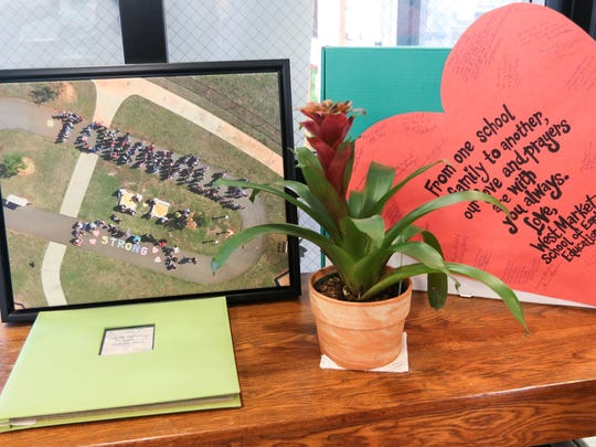 An aerial photo from West Market School of Early Education and a large heart-shaped card from the Anderson school is in the front lobby at Townville Elementary School .