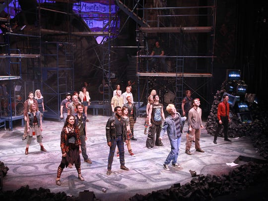 """A production shot from CCM's 2016 production of Green Day's """"American Idiot."""" Music director Steve Goers is visible playing the keyboard on the platform above the actors."""
