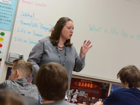 Rochelle Dyer leads her global studies class at Sartell Middle School in 2017.