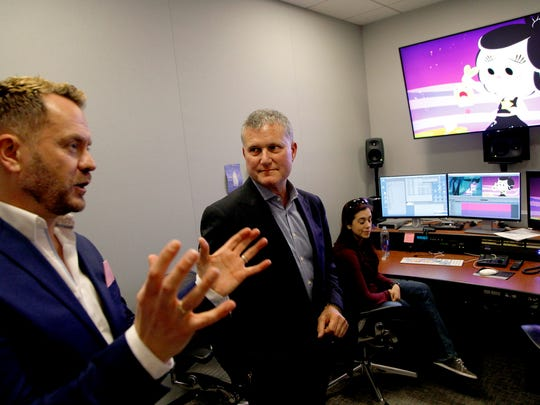 "Hasbro executives Simon Waters (Global Brand Licensing), left, and Steve Davis (Chief Content Officer) view the YouTube animated series ""Hanazuki"" on Jan. 25, 2017 in Burbank, Calif."