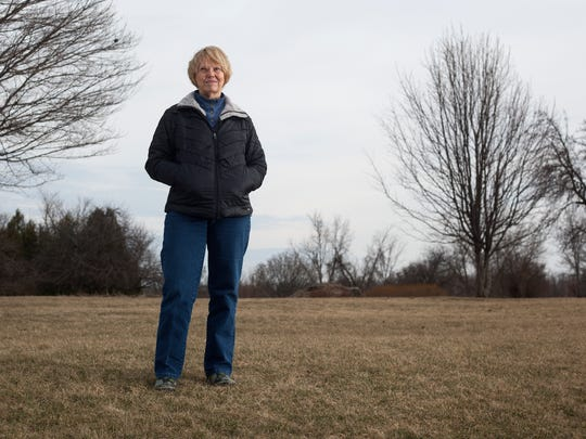 Sue Deer Hall poses for a portrait on Thursday, March 23, 2017 at her home in Grand Ledge. Hall lives next to a portion of up to 500 acres where Geronimo Energy, a Minnesota-based company, is interested in constructing a solar array.