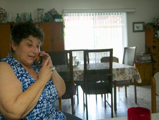 Jeri Vargas takes a phone call at her mother's home