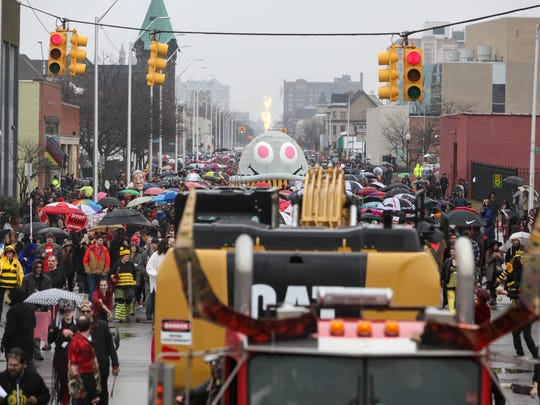 Rain showers did not stop hundreds from attending the 8th Annual Marche du Nain Rouge parade in Midtown Detroit on Sunday, March 26, 2017.