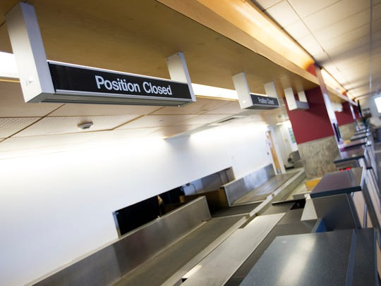 An empty check-in area in the terminal of the Greater
