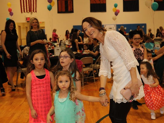 Foreground from left, Layla, 6, Emerson, 4, and mother Erica Antesberger at the mother-daughter dance. In the background is 6-year-old Lily Hoff; her mother, Jeanne Hoff, is not pictured. All of them are from Vestal.