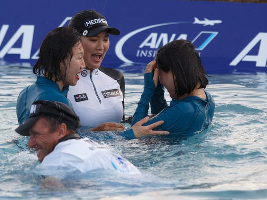 So Yeon Ryu celebrates with her mother, Kwang-Ja Cho, sister, So-Myung Ryu and caddy Tom Watson after winning the ANA Inspiration, Sunday, April 2, 2017.