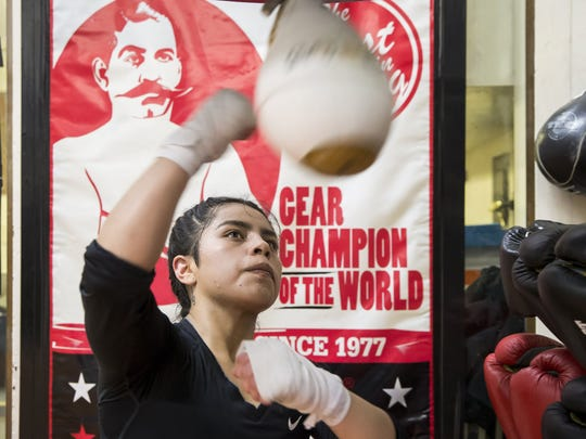 "Vanessa Rojas works on the speed bag at White Center PAL Boxing Gym during practice on Tuesday February 28, 2017 in SEattle. She said her parents initially tried to discourage her from boxing, as it is normally a sport for men. ""After I tried out for gymnastics and I tried out for softball, I told them that I didn't feel comfortable with it, and I feel more comfortable with boxing."""