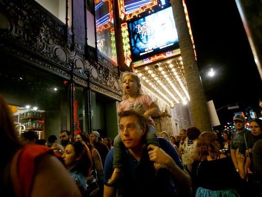 Mariella Braniger, 2, gets a ride on her father Robin Braniger's shoulders as he walks through the crowd outside the Beauty and the Beast Los Angeles premiere at the El Capitan Theatre March 16, 2017 in Hollywood, Calif.