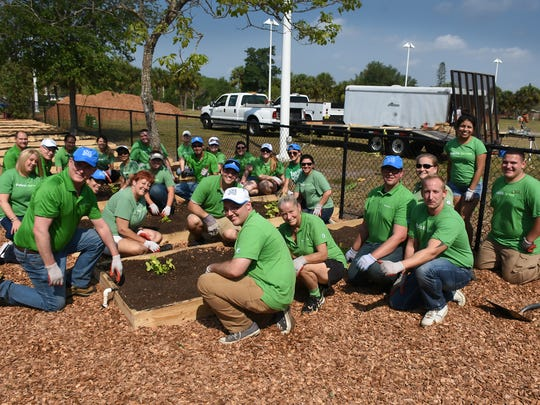 The team poses for a picture as they plant sweet potatoes. On Tuesday, volunteers from Publix got together with representatives from the Blue Zones Project and Collier County Parks & Rec to rejuvenate the Community Garden at the Golden Gate Community Center.