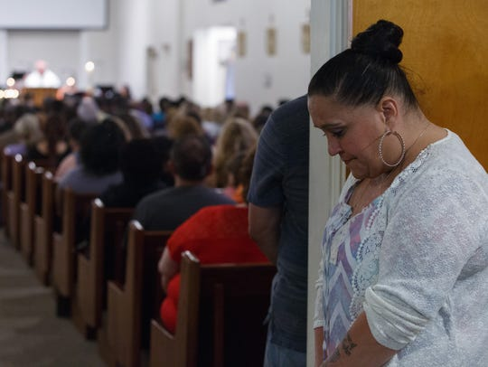 Suzanne Sullivan cries during a prayer service at Our
