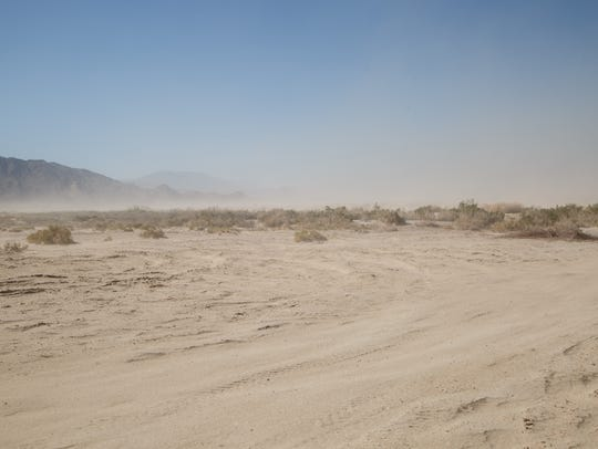 Wind kicks up dust along the Salton Sea shoreline near