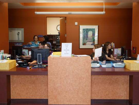 Nurses and medical assistants work in the reception