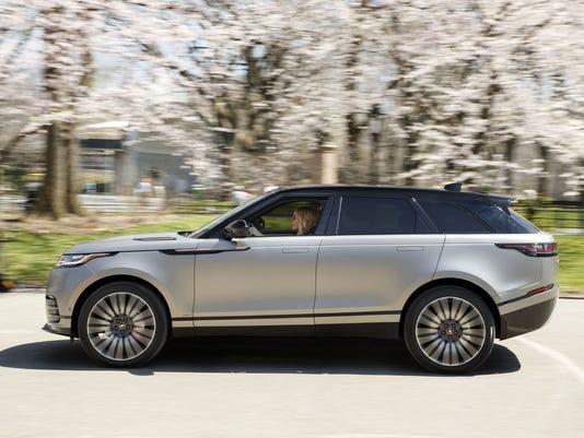636275307868017043-Ellie-Goulding-Driving-Range-Rover-Velar---Driver-Side-Profile.JPG
