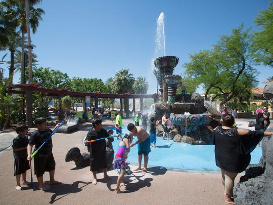 """The """"Fountain of Life"""" in Cathedral City Civic Center offers some escape from the heat as the valley braces for temperatures that could climb as high as 122 by Wednesday, according to the National Weather Service."""