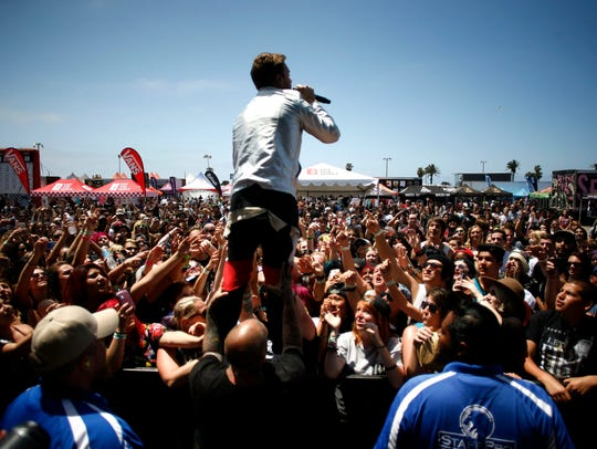 Cody Carson of Set It Off leans out to the crowd during the 2015 Vans Warped Tour in Ventura. After skipping Ventura in 2016 and 2017 due to scheduling conflicts with the Ventura County Fair, the tour is returning to Ventura on June 24. This is the last year of the tour, organizers say.