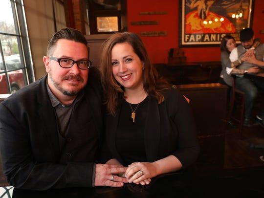 Chris Chatman, left, and his wife Lauren Chatman at