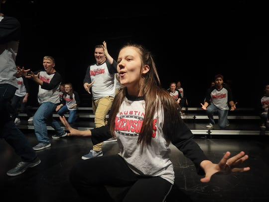 """Courtney Neace, center, found a family and a """"second mom"""" with the Austin High School's Dimensions show choir. She lost her real mother to complications from drug addiction,which is widespread in the Austin, Indiana area."""