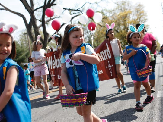 Members of the Girl Scouts Daisy Troop 1237 pass out candy. Members of the Girl Scouts Daisy Troop 1237 pass out candy during  the 25th Annual Frankfort Avenue Easter Parade.  April 15, 2017