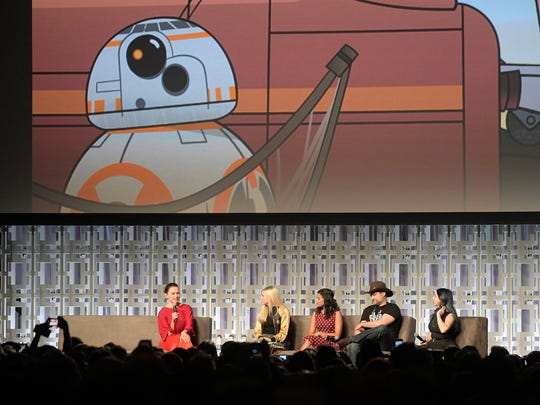 Actress Daisy Ridley, left, answers questions during a panel discussion, called The Heroines of Star Wars, at the Star Wars Celebration event Friday, April 14, 2017 in Orlando, Fla.