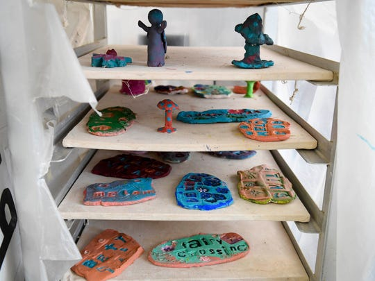 Finished art projects wait to fired in the kiln as children make garden art to be sold at Patchwork Central's pancake breakfast fundraiser this weekend.