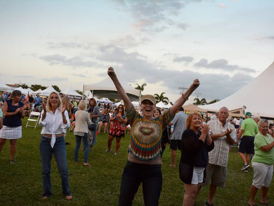 File: Fans show their appreciation for the Ben Allen Band at the Marco Island Seafood and Music Festival.