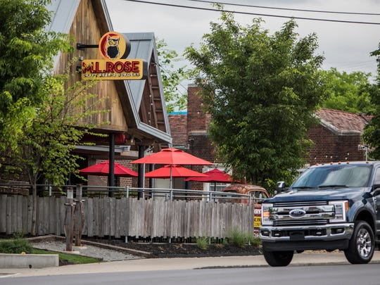 People walk in front of M.L. Rose Craft Beer and Burgers on Charlotte Avenue. The area has been discovered by buyers and renters, from the apartments at the new Hill Center to nearby neighborhoods like Charlotte Park.