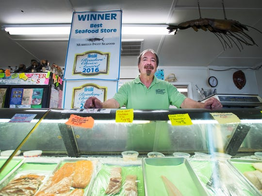 Rick Baumann, founder of Murrells Inlet Seafood, is pictured in his store on Wednesday, April 12, 2017.