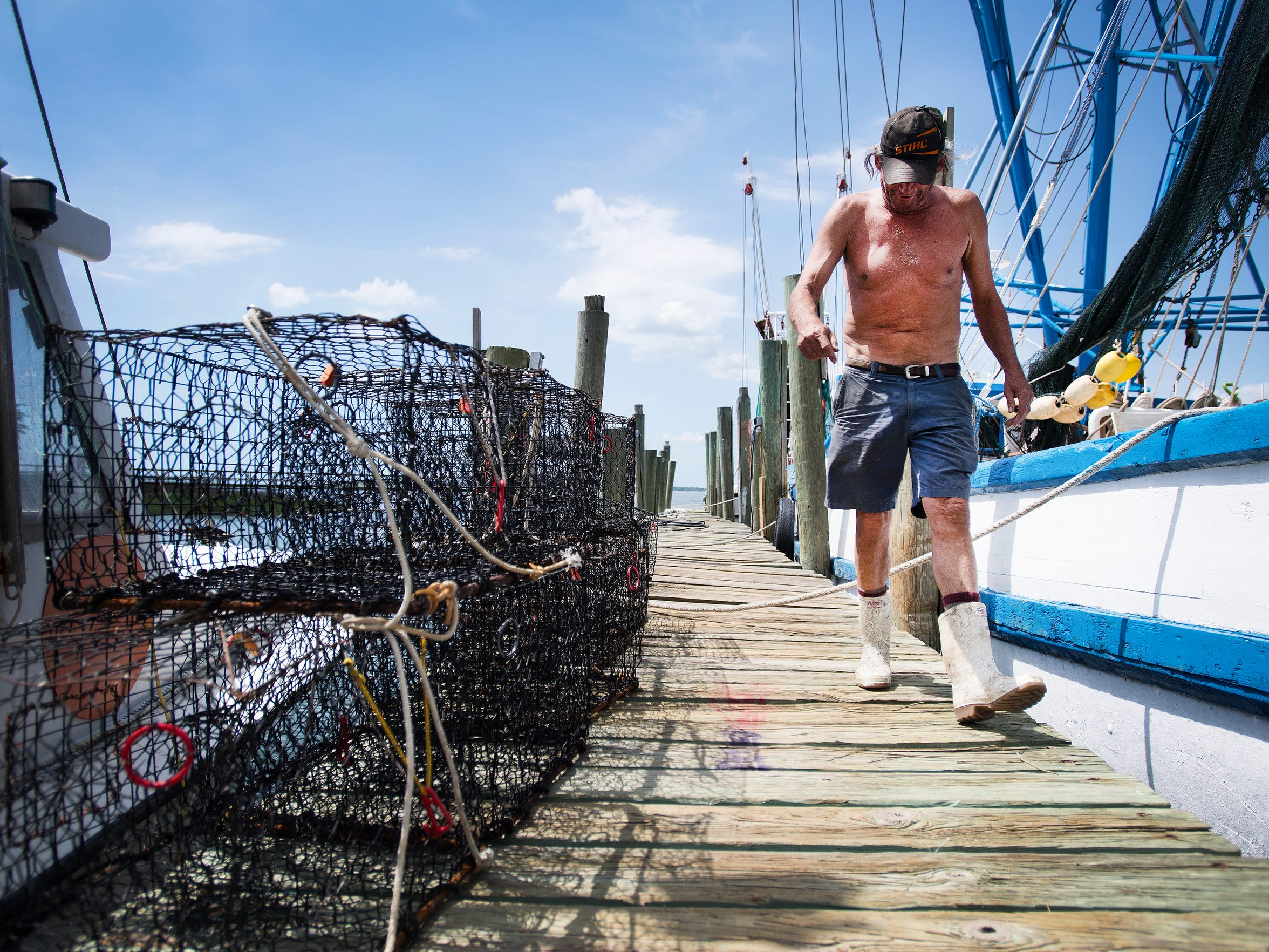 """Joseph Isaac, or """"JoJo"""" walks down Wando Dock as he gets his shrimping boat ready for the season in Mount Pleasant on Thursday, April 13, 2017."""