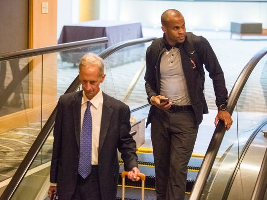 Former U of L basketball graduate assistant Brandon Williams, right, and lawyer Peter R. Ginsberg leave Cincinnati's Westin Hotel following the NCAA hearing Thursday. April 20, 2017