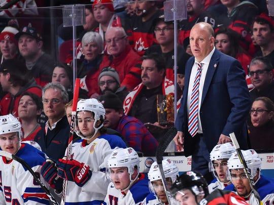Head coach Bob Motzko of Team United States gets on