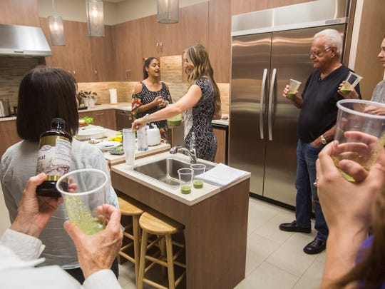 From left, Dipika Patel,  health and lifestyle coach and Tiffany Dalton, nutritionist give advice to a group at Gilda's Club Desert Cities as part of a special cooking and wellness class aimed at cancer patients.
