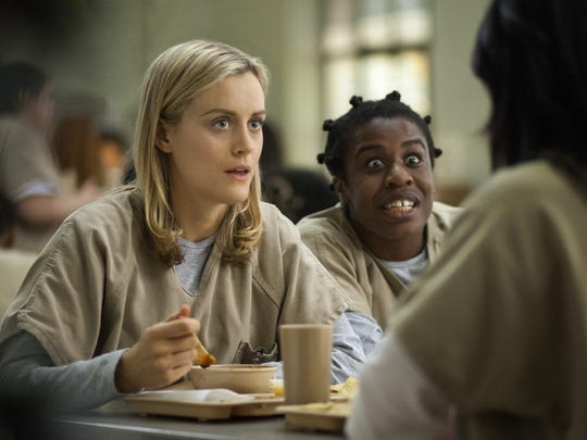 "Taylor Shilling as Piper Chapman (left) and  Uzo Aduba as Suzanne ""Crazy Eyes"" Warren in an episode of ""Orange Is the New Black"" on Netflix."