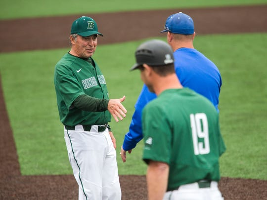 Ed Folli, a volunteer assistant coach with the Binghamton University baseball team, shakes hands with Central Connecticut State coaches after Binghamton lost 3-2 on Saturday, April 29, 2017.