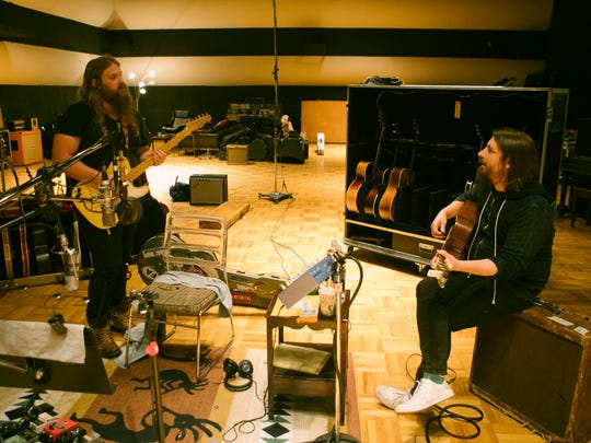 Chris Stapleton works in the recording studio with producer Dave Cobb.