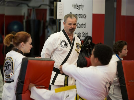 Charles Jackson, owner of Full Circle Dojang Taekwondo, oversees students at his Ocean Township school.
