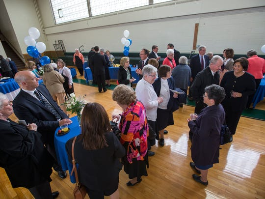 People gather for a reception at St. Thomas Aquinas School honoring the contributions of the departing Daughters of Charity to Lourdes Hospital.
