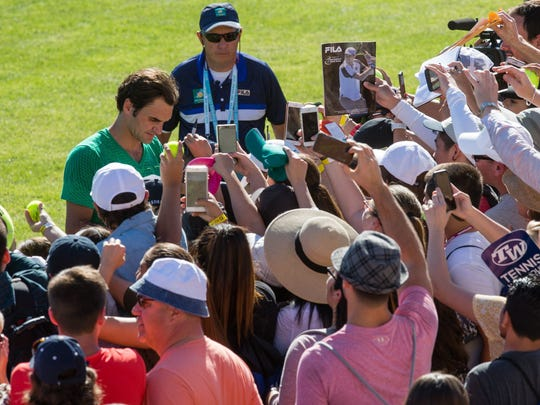 Roger Federer signs autographs for fans at the BNP Paribas Open in Indian Wells on March 8, 2017.