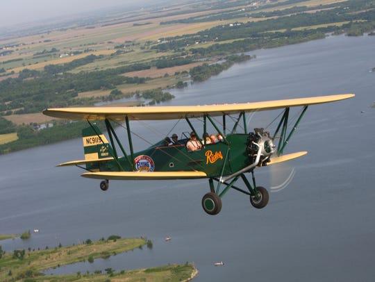 Ted Davis flies his D-25 New Standard, providing an