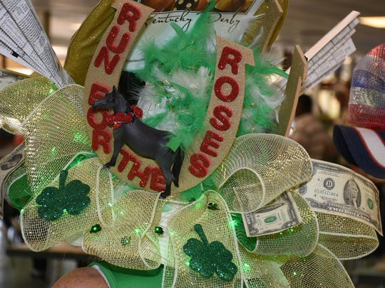 Nancy Dailey's hat cuts to the chase. The Naples-Fort Myers Greyhound Racing track in Bonita Springs hosted a fanciful hat competition Saturday, on the occasion of the Kentucky Derby, with a $1,000 gift certificate as the grand prize.