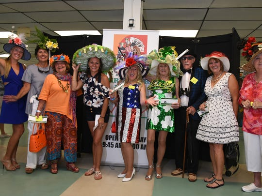 Winners line up for a photo. The Naples-Fort Myers Greyhound Racing track in Bonita Springs hosted a fanciful hat competition Saturday, on the occasion of the Kentucky Derby, with a $1,000 gift certificate as the grand prize.