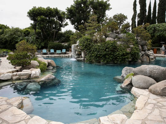 This Wednesday, May 11, 2016, file photo, shows an area of the grounds at the Playboy Mansion in Los Angeles. The Playboy Mansion was among the priciest homes to sell in 2016. Global luxury home sales cooled off in 2016 for the second year in a row, even as a record number of homes sold for more than $100 million, a new report shows.
