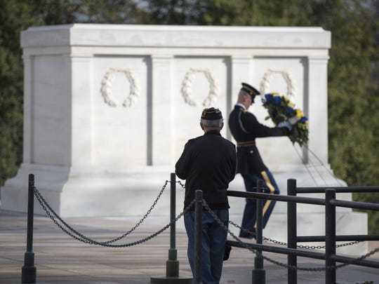 February 25, 2017 -- Arlington, VA, U.S.A  -- A veteran watches as a Tomb Guard sentinel of The Old Guard lays a wreath at the Tomb of the Unknown Soldier in Arlington National Cemetery. --    Photo by Jasper Colt, USA TODAY staff