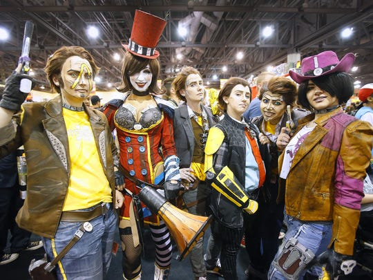 Cosplayers gather in the exhibitor hall during Phoenix