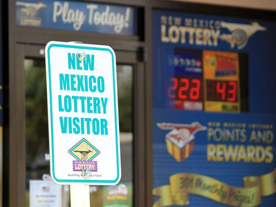 Parking signs greet visitors at the New Mexico Lottery headquarters in Albuquerque, N.M., Thursday, May 18, 2017.
