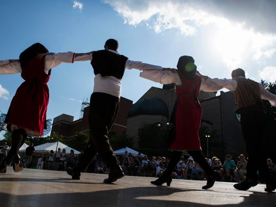 Performers dance during the Greenville Greek Festival at Saint George Greek Orthodox Cathedral on Friday, May 19, 2017.