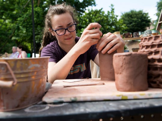 Emily Sizemore sculpts a clay pot during the Clemson Festival of Arts on Saturday, May 20, 2017.