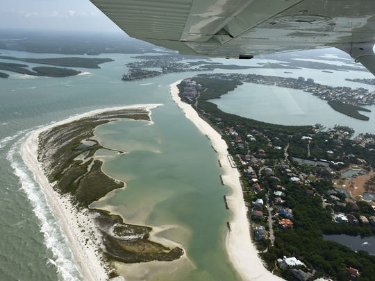 David Ignacio, 14, banks a Cessna 172 over Marco Island. Every month, veteran aviators of the EAA offer to take up young people flying, free of charge, for a flight during which the youngster gets the chance to take the controls of the plane.